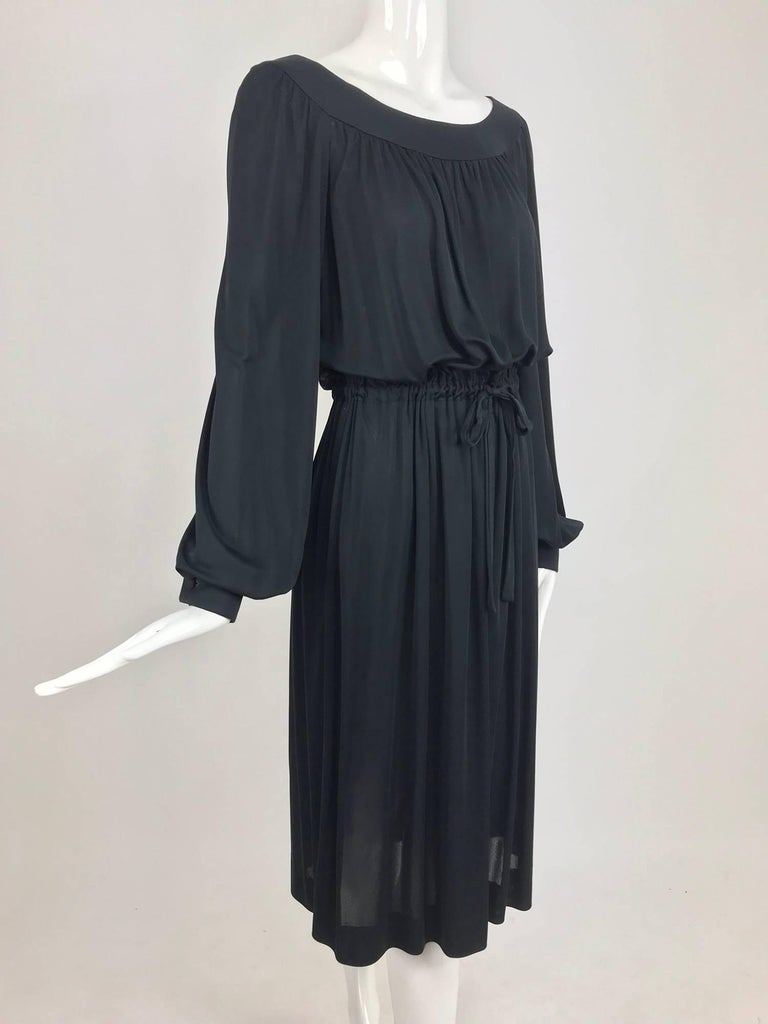 Pucci Black silk jersey draw string waist dress from the 1960s. The perfect little black dress for summer. Pull on dress of semi sheer silk jersey, has a banded yoke neckline with full raglan sleeves that gather into banded button cuffs, the bodice