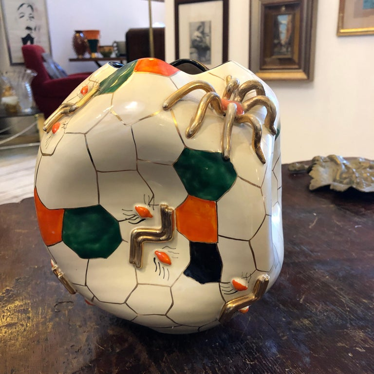 This is one of the most important vase made by Domenico Pucci. It's a cubic spider vase designed and made in 1952, it's on the cover of the book of Pucci ceramics.
