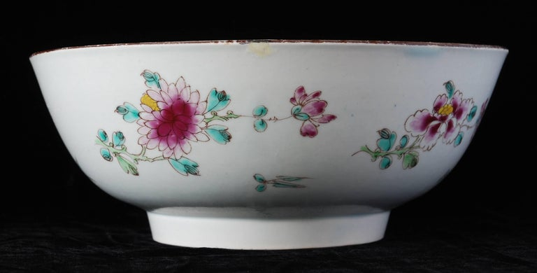 A rather splendid punch bowl from the Bow Porcelain Factory, enameled with flowers and insects in the Famille Rose style.