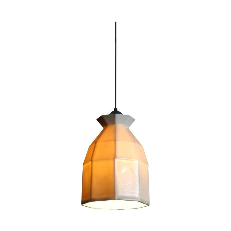 Expansion 2 is a modern twist on a Classic pendant form. The geometric curves sit beautifully over tabletops and work spaces.