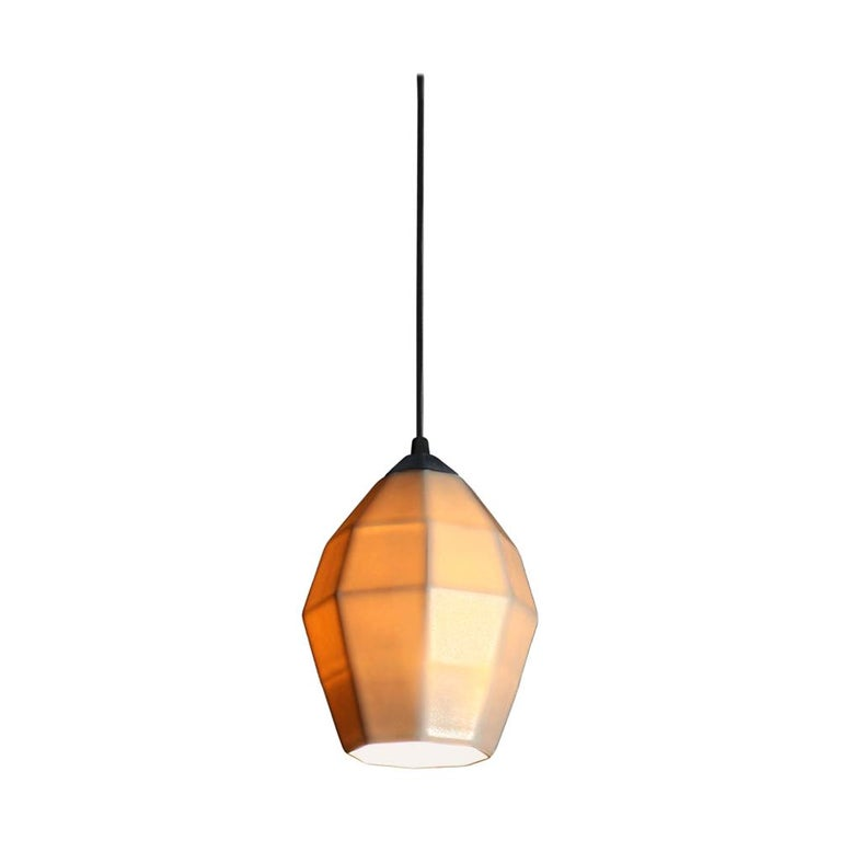 7.5 inch hanging pendant light the smallest of the Extension collection, this hanging pendant emits a soft, elegant glow through a translucent geometric porcelain shade, shining direct downward light through the open base. It's the perfect modern