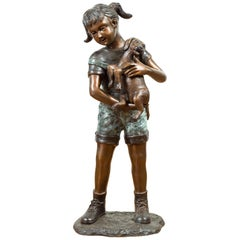 Puppy Kisses, Contemporary Bronze Cast Statue of a Little Girl Holding Her Puppy