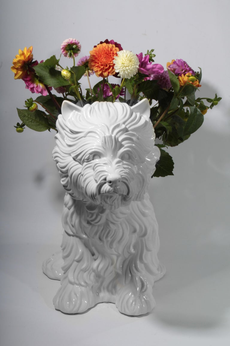 """Jeff Koons puppy vase made from white glazed porcelain. The design took cues from Koons's mongo-sized puppy sculpture (1992), which was filled with over seventeen thousand flowers. """"The vase is a symbol of love, warmth, and happiness,"""" says Koons."""