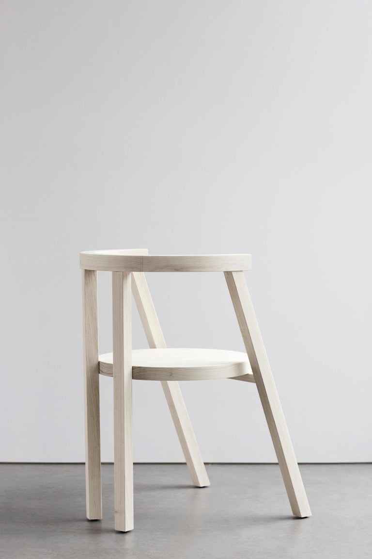 The AA103 chair, part of the 'Pure Minimalist' Collection by Amee Allsop, makes a bold statement with its minimal, architectural form. The 1.5