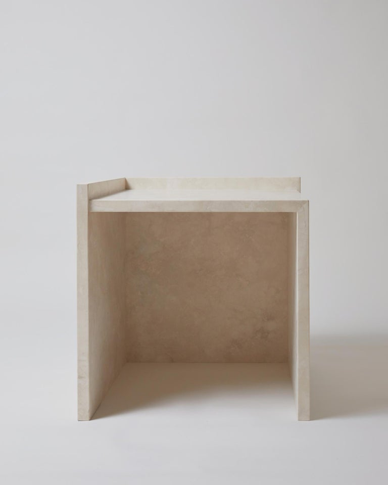 The AA112 bedside table set, part of the 'Pure Minimalist' collection by Amee Allsop, is a simple yet architectural design with a focus on the material and form. It is elegantly constructed of 3cm solid ivory travertine that is filled, honed and