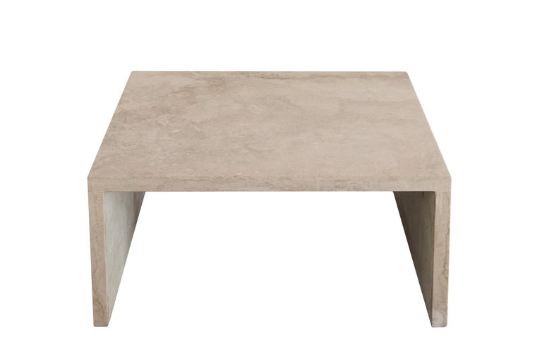 The AA106.2 low side table, part of the 'Pure Minimalist' collection by Amee Allsop, is a simple design that is elegantly constructed of 3cm solid ivory travertine that is filled, honed and sealed. This piece can also go with AA106.1 coffee