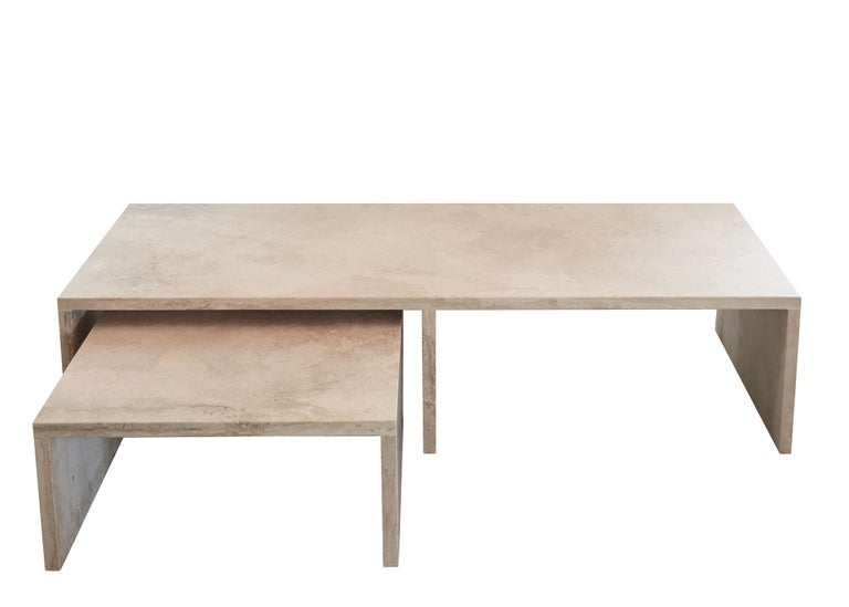 The AA106 coffee table set, part of the 'Pure Minimalist' Collection by Amee Allsop, is a simple yet architectural design with a focus on the material and form. It is elegantly constructed of 3cm solid ivory travertine that is filled, honed and