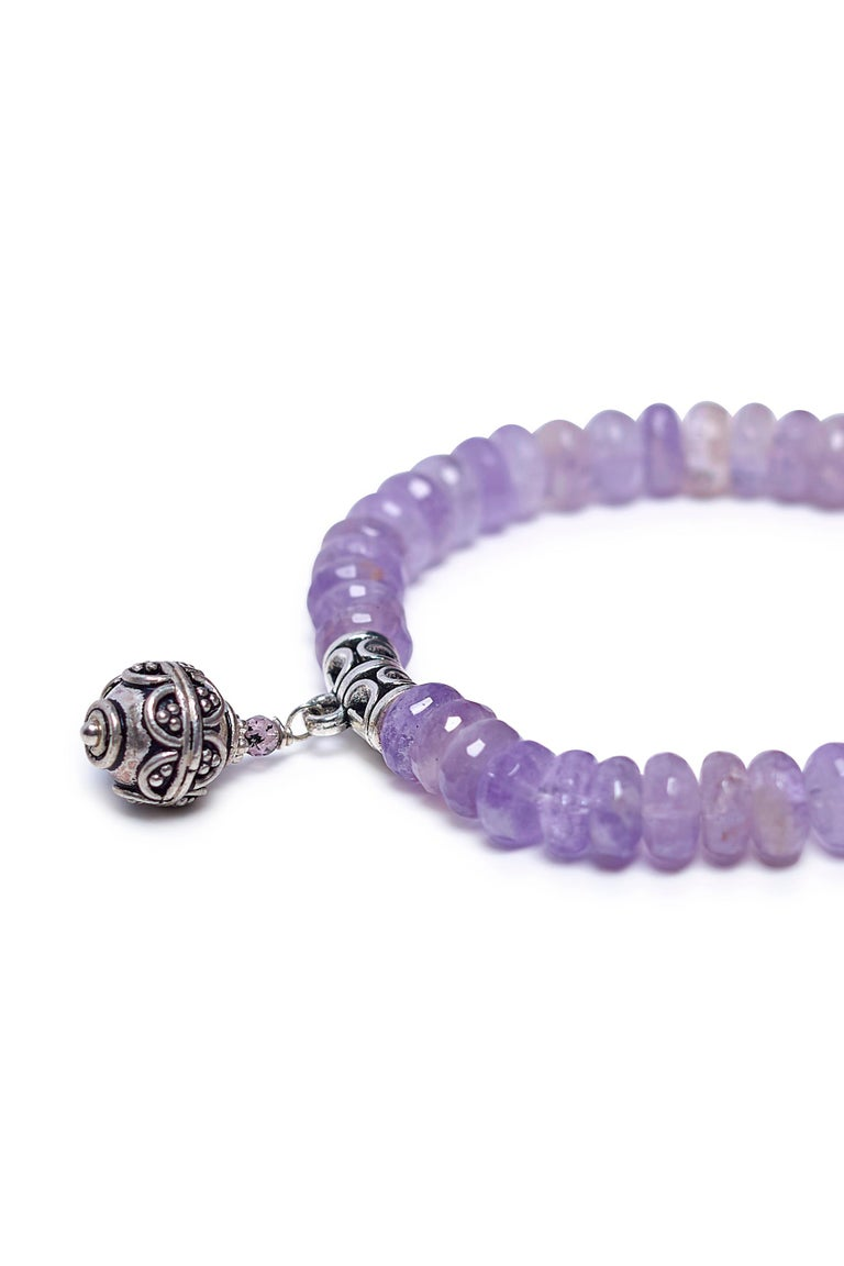Story Behind the Jewelry The unique translucent lavender amethyst is adorned with sterling silver Balinese accents.  The combination of tranquil Bali elements and the peacefulness of the amethyst stone brings balance to one who is struggling with