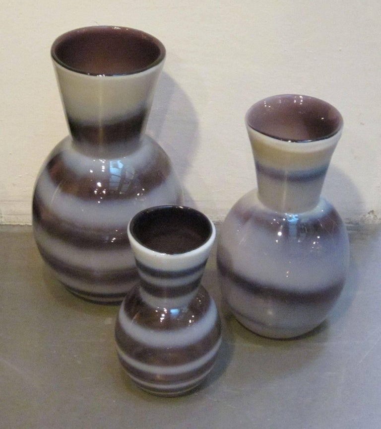 Contemporary Chinese set of three purple and white horizontal stripe glass vases.