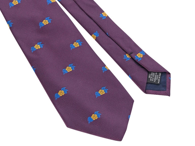 Product details:  Purple and multicolor patterned silk tie by Chanel. Self-tie. Style with a striped cotton-poplin button-up shirt 57