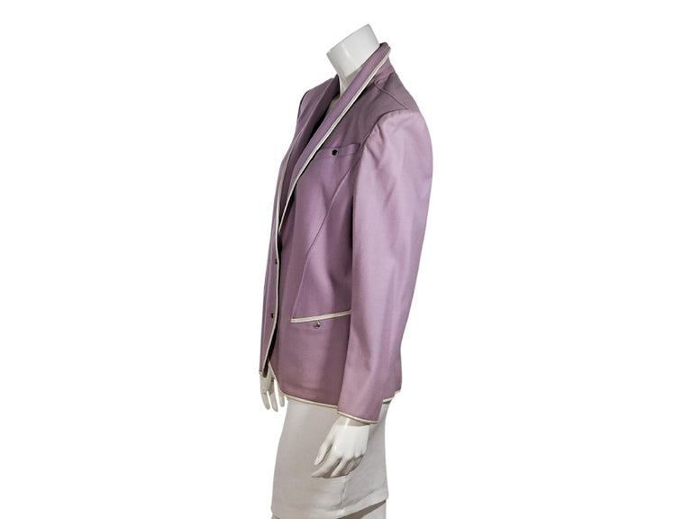 Product details:  Vintage purple wool jacket by Thierry Mugler.  Trimmed with white leather.  Shawl collar.  Long sleeves.  Snap-front closure.  Chest and waist snap pockets.  Silvertone hardware.  36