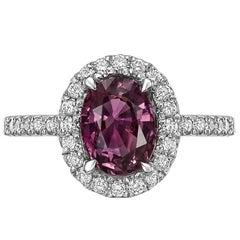 Purplish-Pink Sapphire and Diamond Halo Ring