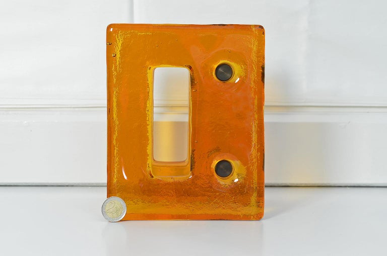 Push and pull door handle in orange glass with brass fittings, France, 1970s.