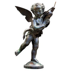 Putto with Dolphin Sculpture