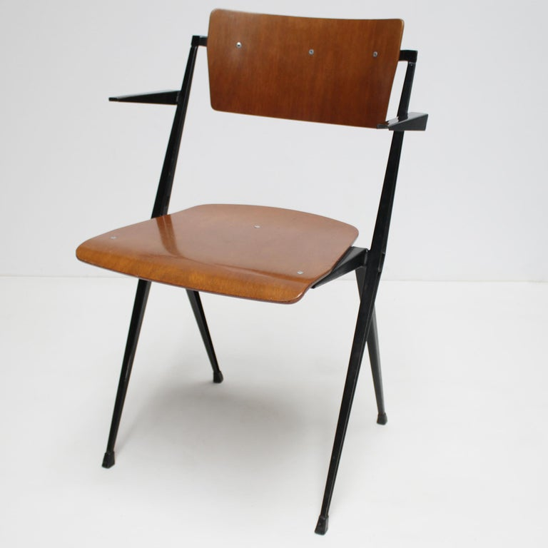 Pyramid armchair by Dutch designer Wim Rietveld for De Cirkel, Holland. Lacquered steel frame with a plywood seat and backrest. Stamped with date of production: 23 December 1965 (see picture). Dimensions: Height 31.9 in. (81 cm), width 20.9 in. (53