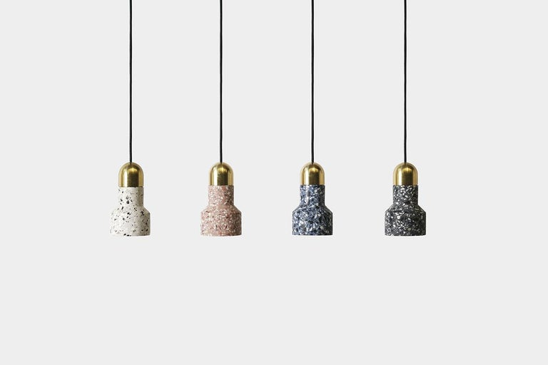 Terrazzo pendant lamps designed by Cantonese studio Bentu Design  Black wire 2m adjustable. Bulb E27 LED 3W Measures: 17.5 cm x 9.6 cm  These pendant lamps are available in different colors of terrazzo: white, black, red or blue.  Bentu
