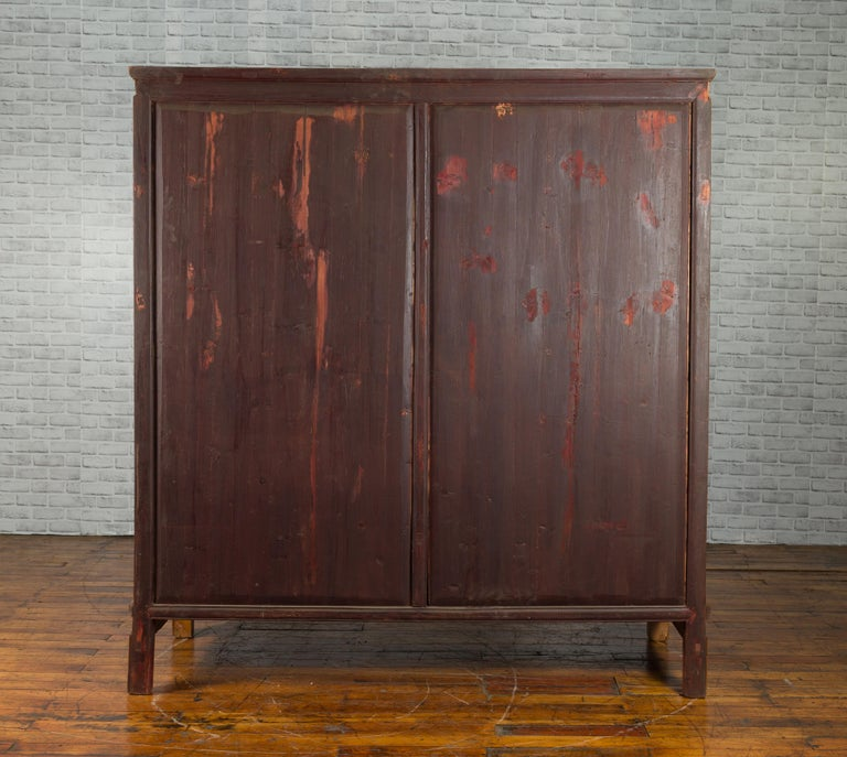 Qing Dynasty 19th Century Chinese Hand Carved Armoire with Gilt Painted Panels For Sale 9