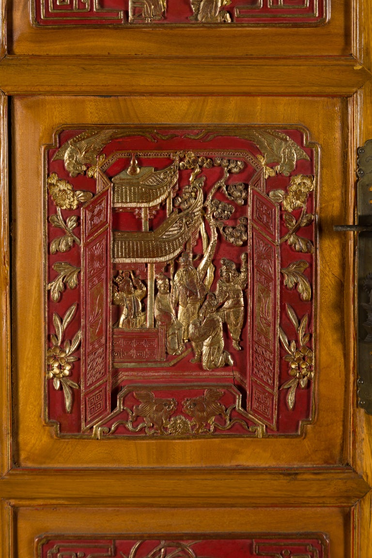 Qing Dynasty 19th Century Chinese Hand Carved Armoire with Gilt Painted Panels For Sale 12