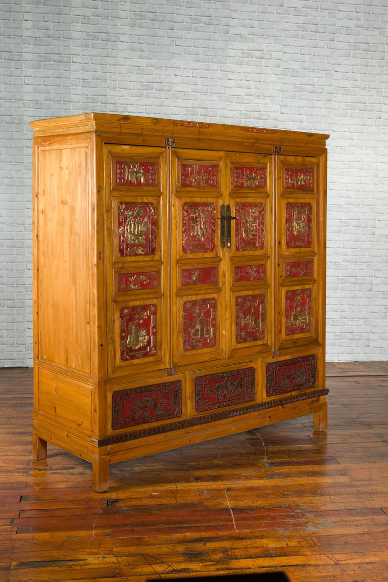 Asian Qing Dynasty 19th Century Chinese Hand Carved Armoire with Gilt Painted Panels For Sale
