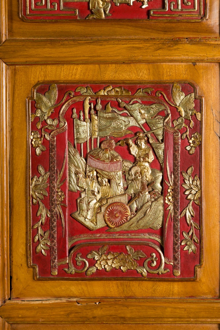 Qing Dynasty 19th Century Chinese Hand Carved Armoire with Gilt Painted Panels In Good Condition For Sale In Yonkers, NY