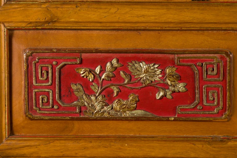 Wood Qing Dynasty 19th Century Chinese Hand Carved Armoire with Gilt Painted Panels For Sale