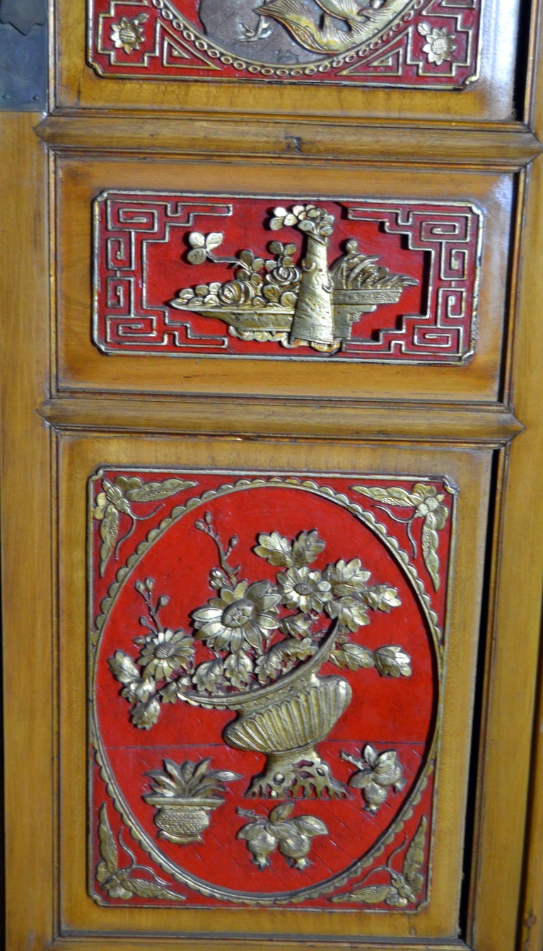Qing Dynasty 19th Century Chinese Wooden Armoire with Hand-Carved Gilt Panels 7