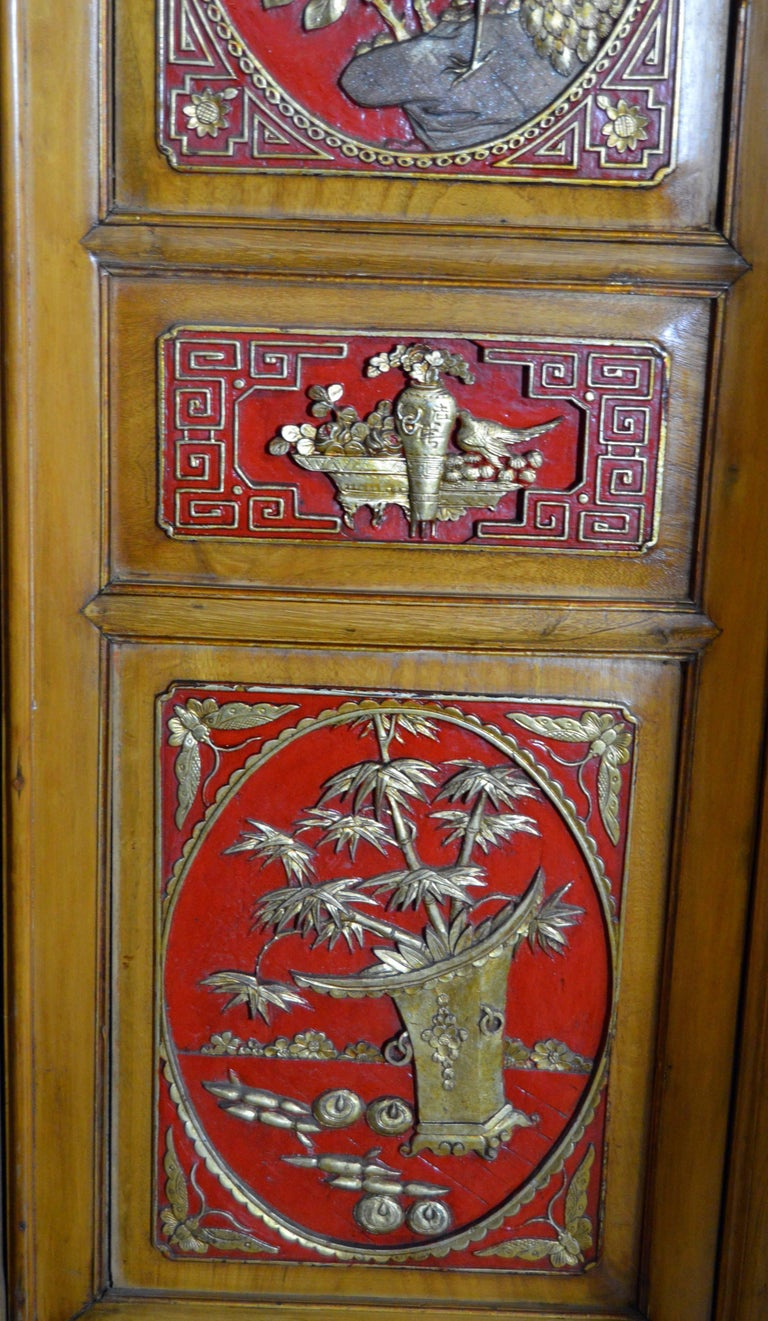 Qing Dynasty 19th Century Chinese Wooden Armoire with Hand-Carved Gilt Panels 8