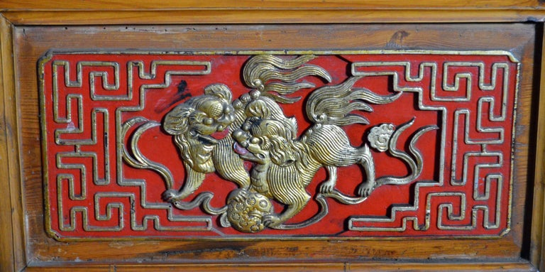 Qing Dynasty 19th Century Chinese Wooden Armoire with Hand-Carved Gilt Panels 9