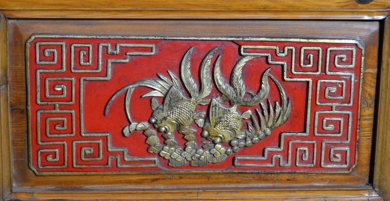 Qing Dynasty 19th Century Chinese Wooden Armoire with Hand-Carved Gilt Panels 10