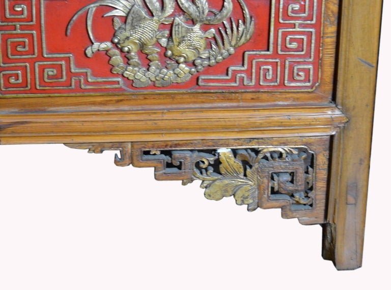 Qing Dynasty 19th Century Chinese Wooden Armoire with Hand-Carved Gilt Panels 11