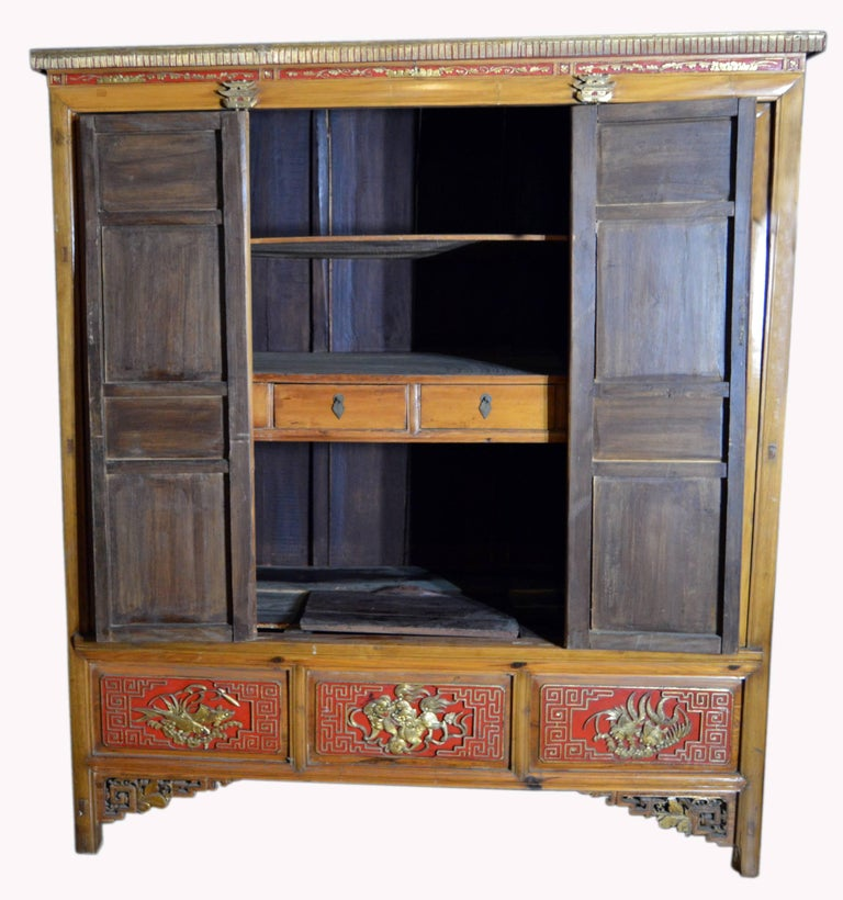 Qing Dynasty 19th Century Chinese Wooden Armoire with Hand-Carved Gilt Panels 12