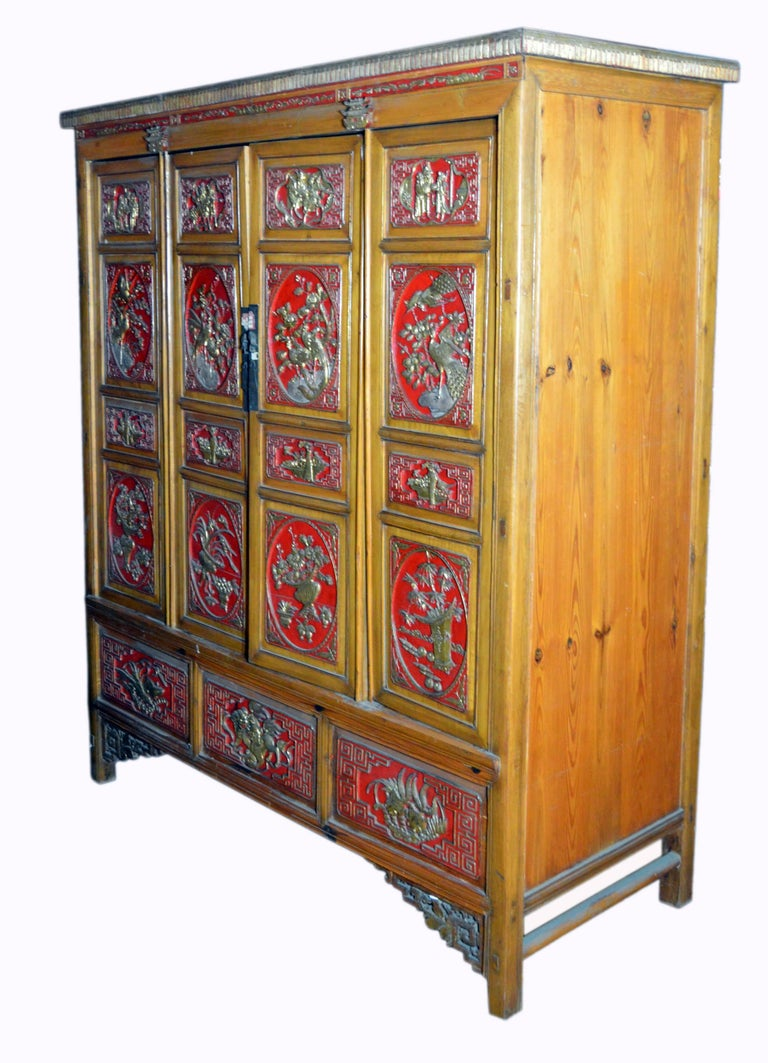 Qing Dynasty 19th Century Chinese Wooden Armoire with Hand-Carved Gilt Panels 13
