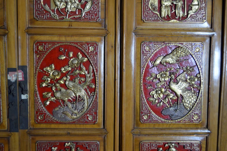 Qing Dynasty 19th Century Chinese Wooden Armoire with Hand-Carved Gilt Panels 3