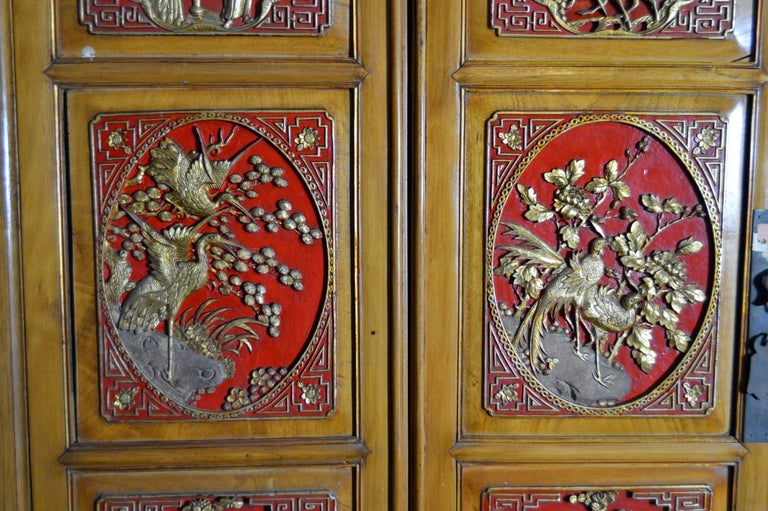 Qing Dynasty 19th Century Chinese Wooden Armoire with Hand-Carved Gilt Panels 4