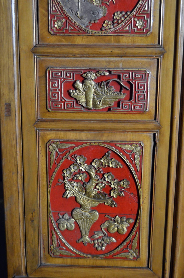 Qing Dynasty 19th Century Chinese Wooden Armoire with Hand-Carved Gilt Panels 5
