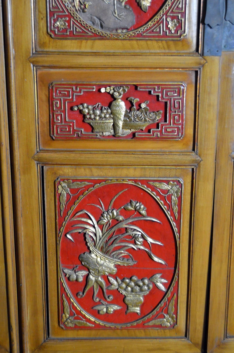 Qing Dynasty 19th Century Chinese Wooden Armoire with Hand-Carved Gilt Panels 6