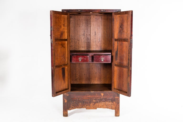 This Qing dynasty cabinet is from Shanxi, China and dates to the mid-1800s. It was originally used to provide extra storage in the dining or sleeping areas of a comfortable home. This piece features two drawers and a pair of doors. It is made from