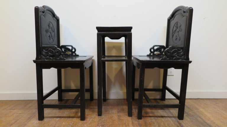 A late Qing dynasty Zitan wood chair set with table. Very nice table with two chairs made of rare Chinese hardwood, Zitan wood. The wood is very heavy and dense, sometimes referred to as Iron Wood. Color is blackish purple on finished sides. In very