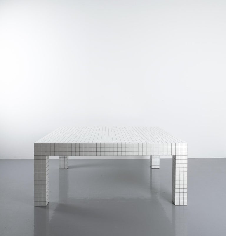 Rare iconic coffee or couch table designed by the Italian radical design group Superstudio, for Zanotta, 1970. Table laminate finish with 3 cm square grid motif. Labelled Zanotta in good condition, one minor nick on one of the legs.  Literature:
