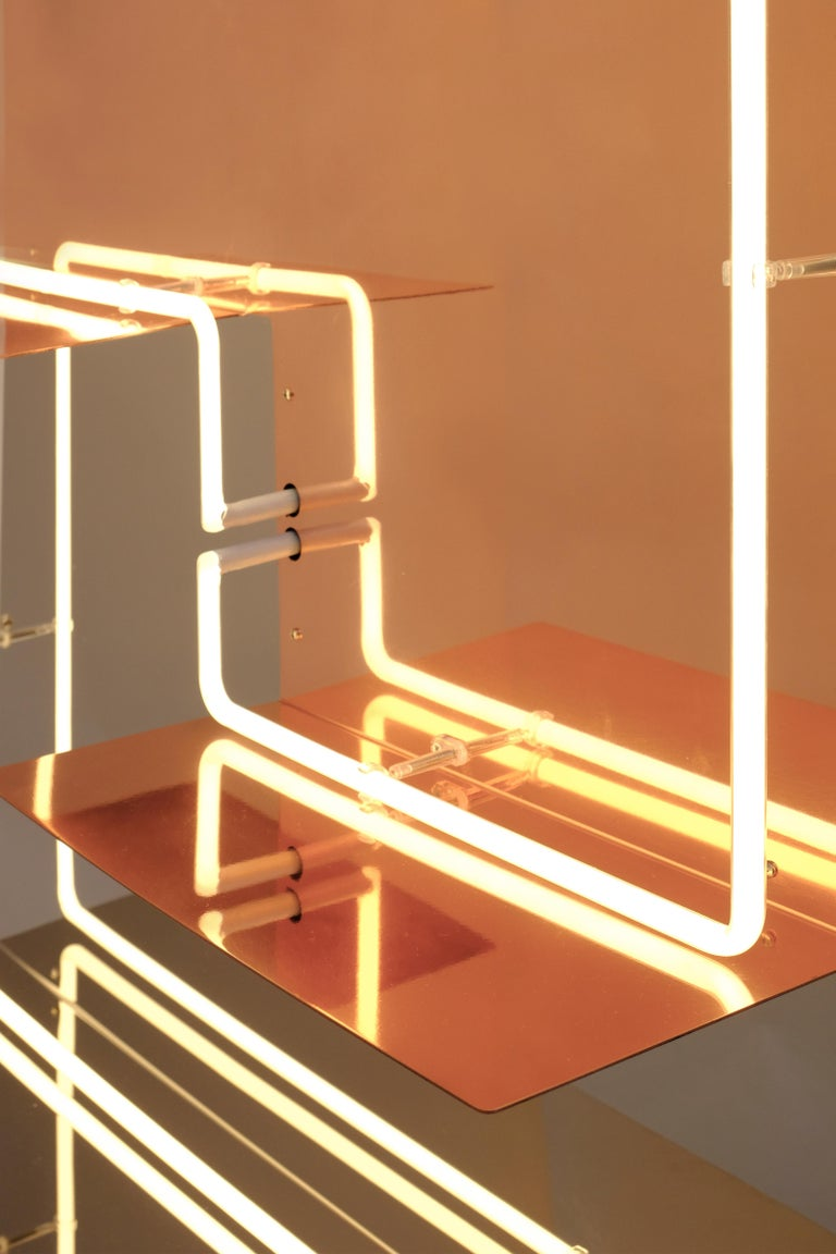 Quadri Luminosi' or 'Bright artworks' is a limited edition of supermirror shelves with a luminous graphic design which runs around it. The metal materials, stainless steel supermirror and polished copper reflect the ambience in which they are hung,