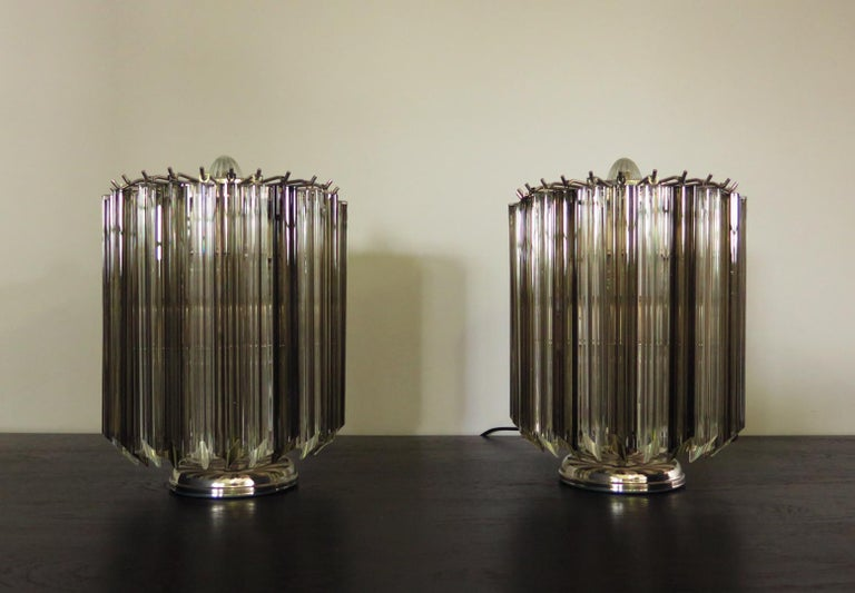Magnificent pair of table lamps, 24 transparent and smoked Quadriedri for each lamp. Elegant object of furniture. Period: late 20th century Dimensions: 15 inches (38 cm) height, 10.50 inches (27 cm) diameter. Dimension glasses: 11 inches (28 cm)
