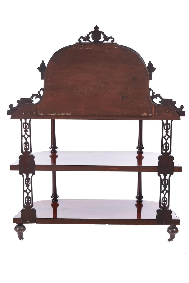 Quality antique Victorian mahogany carved mirror back whatnot having a lovely carved mahogany mirror back, quality mahogany top supported by 4 turned columns, 4 fret work supports, 2 mahogany shelves standing on turned mahogany feet with original