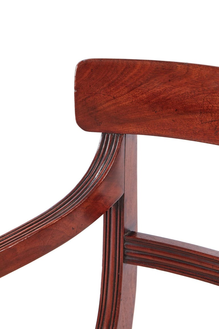 Quality pair of george III mahogany elbow/desk chairs,with a lovely shaped top rail, reeded centre rail, lovely shaped reeded scroll arms, newly recovered seats, standing on turned legs to the front outswept back legs Lovely color and