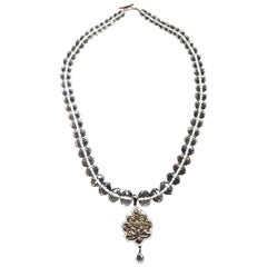 Quartz Beaded Necklace with a Blackened Silver Pendant Set with Sapphires