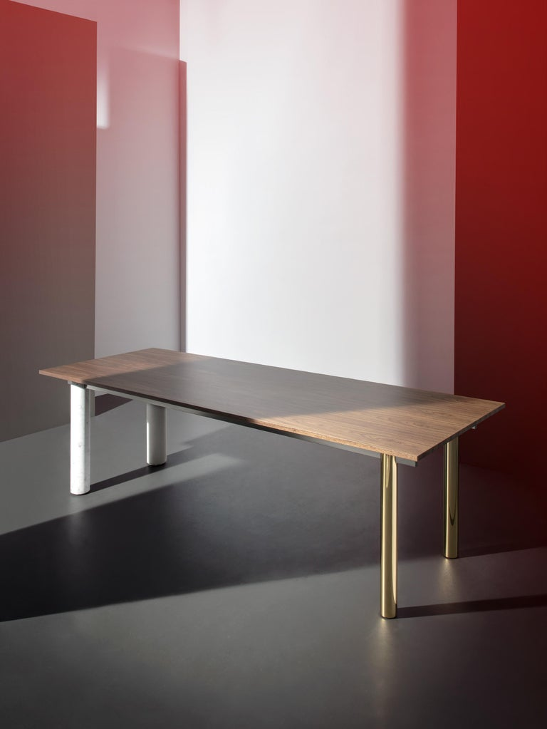 Quattro Gambe is a contemporary table system with its focus on materials. It is a combination of wood, metal, and mineral, customizable at will. The top and the legs can be in walnut, lacquered walnut, marble, metal, or even concrete. This makes