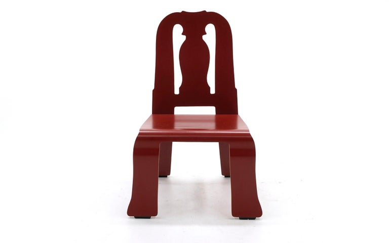 Rare red Queen Anne chair designed by Robert Venturi and Denise Scott brown and manufactured by Knoll. Very minor signs of wear. A fine example of this Postmodern design.