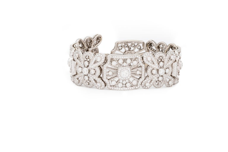 The Queen Anne Lace bracelet by Katherine LeGrand- Custom Goldsmith of Aspen, Colorado combines Katherine's love of the Art Deco and Edwardian periods.  Inspired by various museum fashion collections, the handmade 18 Karat white gold bracelet