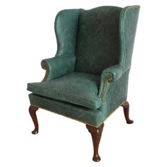 Queen Anne Leather Upholstered Wingchair