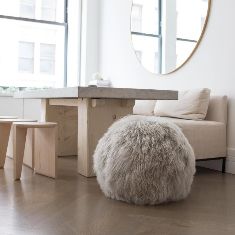 Crafted with silver/grey Tibetan lambskin shearling, the Hudson Ottoman exudes luxury. Designed for seating or as playful and sculptural decor. We individually hand cut, sew and fill each ottoman with hand-compressed micro-foam in our Brooklyn