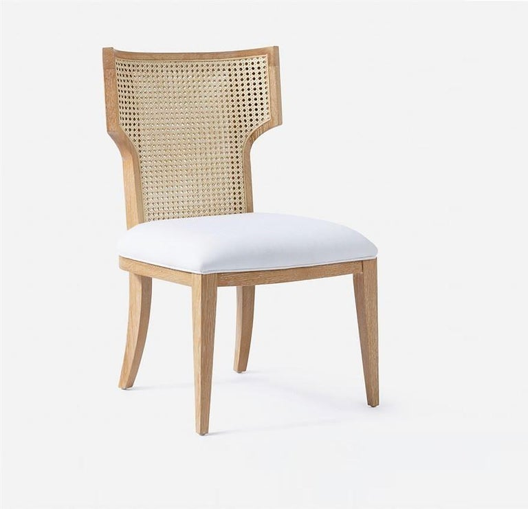 A modern interpretation of a classic, this set of 8 wing-backed chairs features natural oak frames and are upholstered in a choice of your own fabric or leather.   The simple, iconic design of this chair can translate well with all design aesthetics